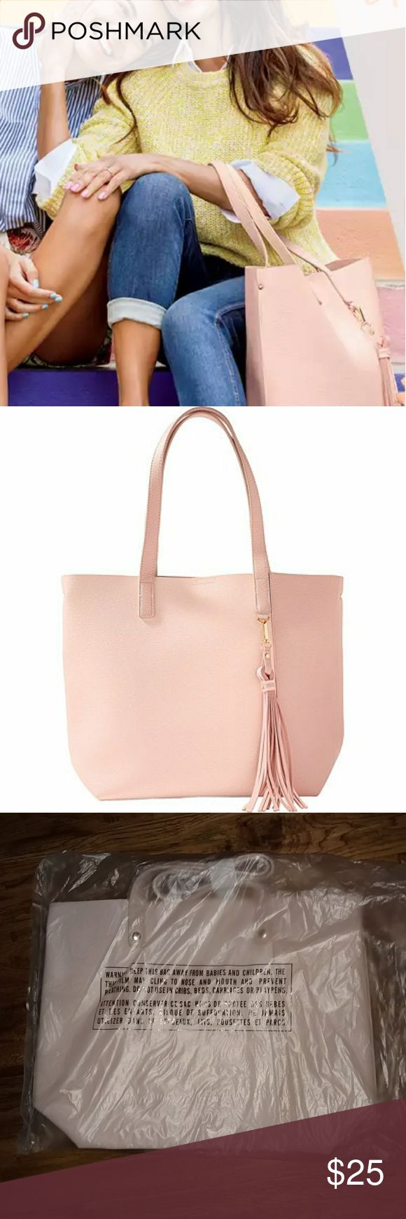 "Large Convertible Blush Pink Tote Large blush pink tote with long, tassle zipper pull.   Polyester, soft vegan leather feel.   A convertible tote that can transform from your classic tote into a bucket tote bag for double styling options.  Measure approximately 18.5"" wide by 14 tall  New with tags. boutique Bags Totes"