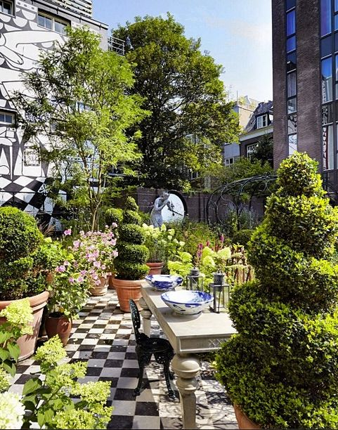 A visit to the gardens of @AndazAmsterdam reveals just a sampling of the whimsical designs created by Dutch artist Marcel Wanders. We can't think of a better place for an Alice-inspired #teaparty.