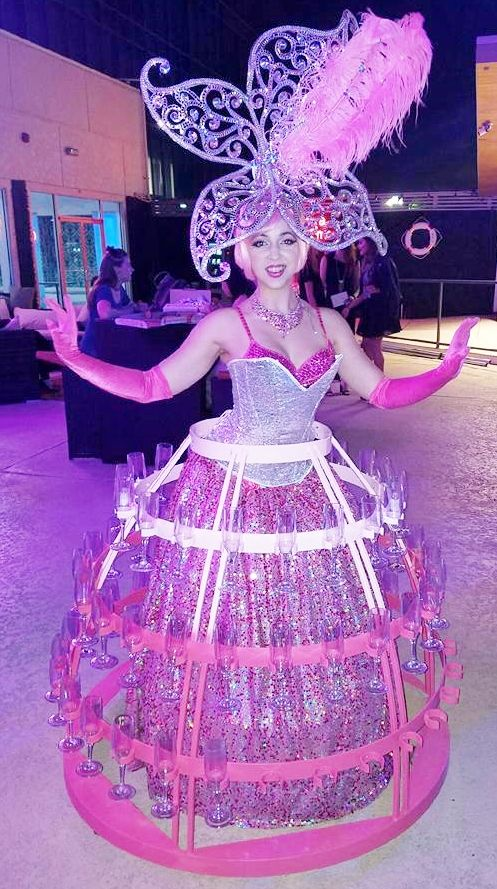 J & D Entertainment's beautiful Pink Butterfly Champagne Diva will make a statement at your next event with beautiful lush costuming & personable beautiful TABC certified Diva. www.jdentertain.com