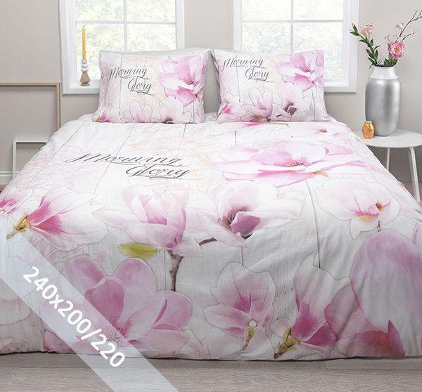 Essara dekbedovertrek 'Morning Glory'. Een lits-jumeaux (240x200/220 cm) dekbedovertrek van 100% katoen met als basis een achtergrond van wit houten planken. Daarop grote roze orchideeën en de tekst 'Morning Glory'.
