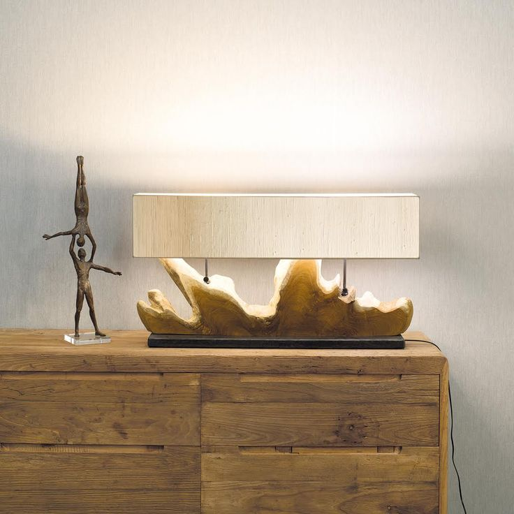 SUNSET | A section of tree trunk is transformed into a design lamp by the expert hands of Nature Design cabinet makers. The base in raw metal with a transparent finish and the shade of your choice complete a truly unique piece of furniture.  #NatureDesign #madeinitaly