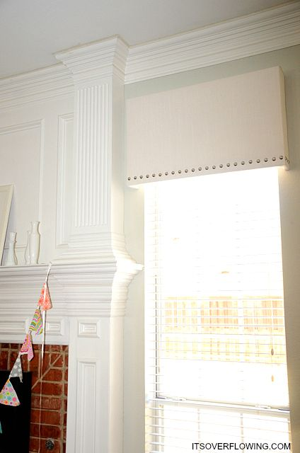 DIY Nailhead Cornice Board Makeover - this might be a good idea for blacking out the boy's room.  The light that comes through the top of the curtains always wakes them up.