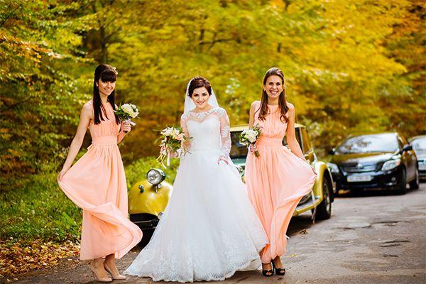 Bride and bridesmaids posing outside