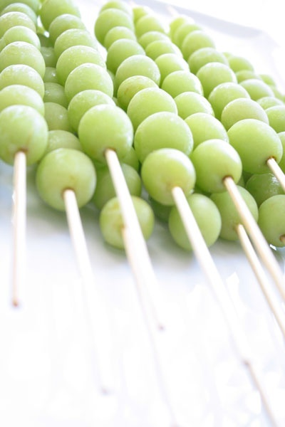 Perfect for parties or showers: frozen grape skewers. Put in drinks to keep them cold w/o watering drink down.