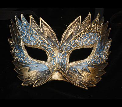 Flash azzurro e oro V10 - Maschera realizzata a mano in cartapesta, colori acrilici, glitter e decorata con passamaneria.