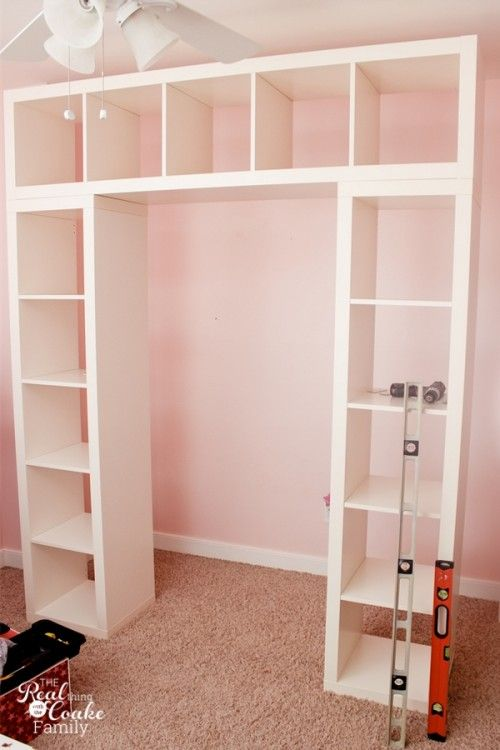 IKEA Expedit hack - I'd use this in a closet, with clothes rails in between the shelves & crown molding at the top to make it look built in