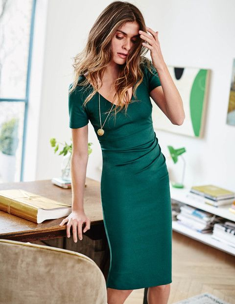 Say hello to slinky sophistication with this classic fitted dress. It's slim-fitting and ruched on one side for instant va-va-voom, with a flattering empire waist and scooped V-neck. Wear with a statement necklace and stacked heels for a look that will take you from desk to dinner (to ill-advised karaoke bar).