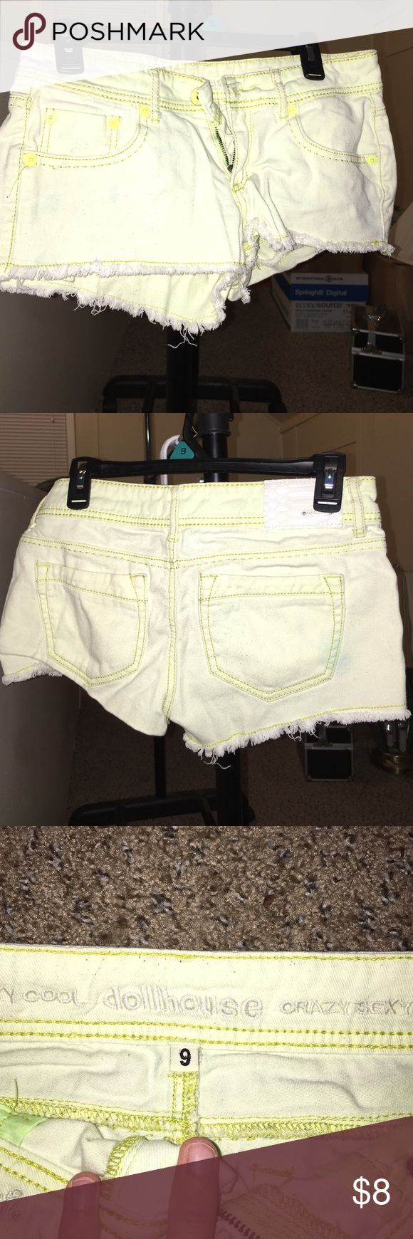 Neon yellow shorts Worn a few times. Some discolor from a black shirt but not noticeable when wearing. Dollhouse Shorts Jean Shorts