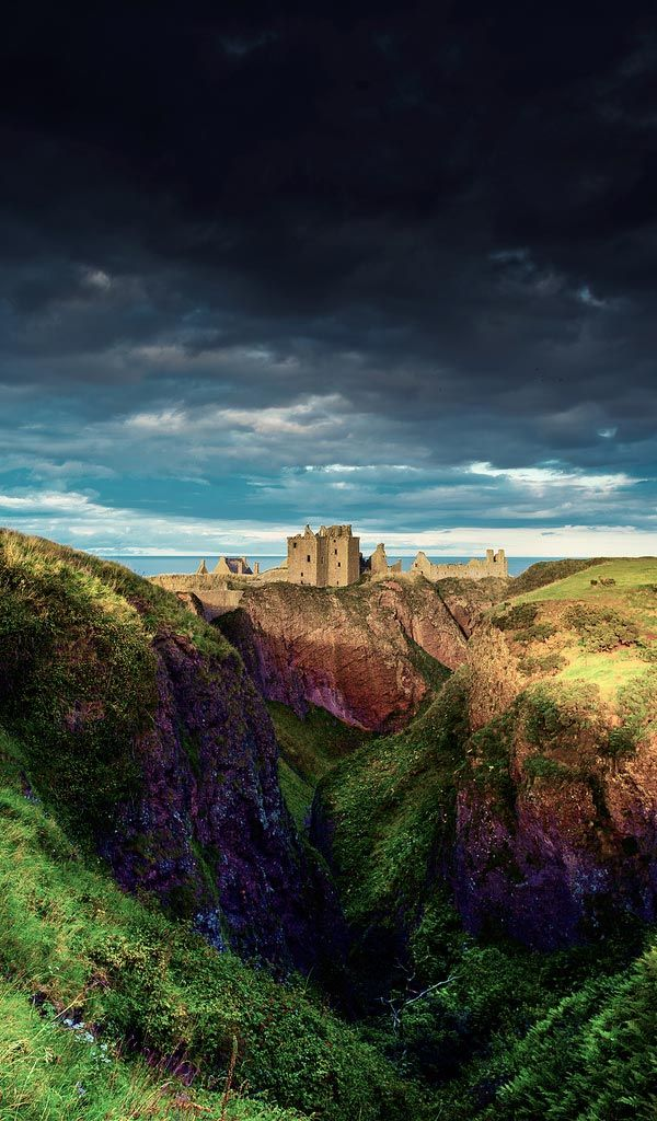 "Dunnottar Castle, Scotland  |  Dunnottar Castle (Scottish Gaelic: Dùn Fhoithear, ""fort on the shelving slope""[1]) is a ruined medieval fortress located upon a rocky headland on the north-east coast of Scotland, about 3 kilometres (1.9 mi) south of Stonehaven. The surviving buildings are largely of the 15th and 16th centuries, but the site is believed to have been fortified in the Early Middle Ages."