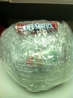 Candy Ball Game for big kids - jingle bell at the center, wrap with layers of bubble wrap, candy, packing plastic, tape. To play - kids in circle, one kid tries to unwrap candy till another kid rolls doubles with dice, pass to the left for another turn. Rolling doubles with the dice acts as a timer for each turn.