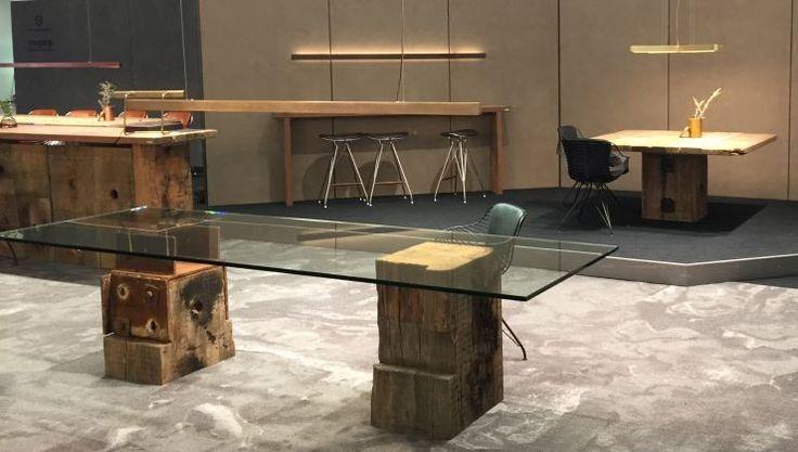 Unika glas table at the Stockholm furniture fair #glasstable #antiquewood #danishdesign #corporatefurniture #interiors