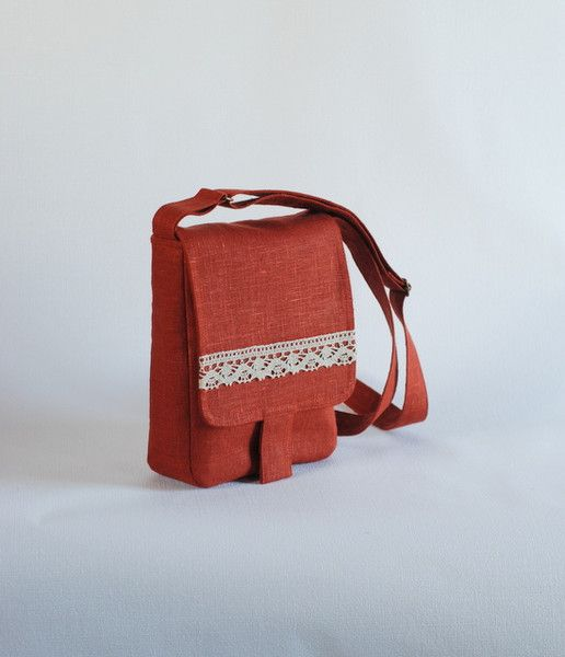 Ready to go!          Small messenger bag. Color is dark red, brick red. Closes with magnetic snap, inside zip pocket and side pocket.  Measurements: 18 cm (7 inches) wide 24 cm (9,5...