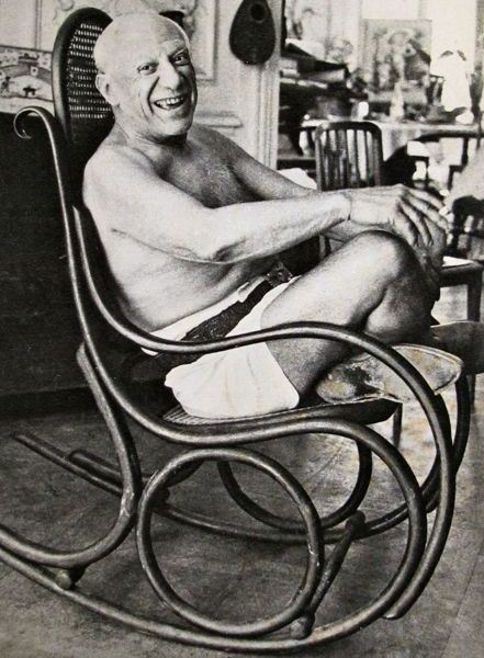 Pablo Picasso in his Thonet rocking chair in his studio 'Villa La Californie'