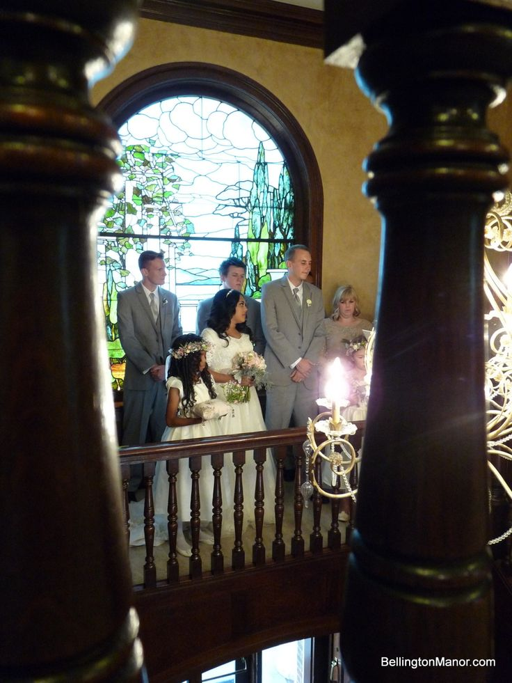 Exchanging Rings In Front Of The Garden Stained Glass Window At Bellington Manor Ogden