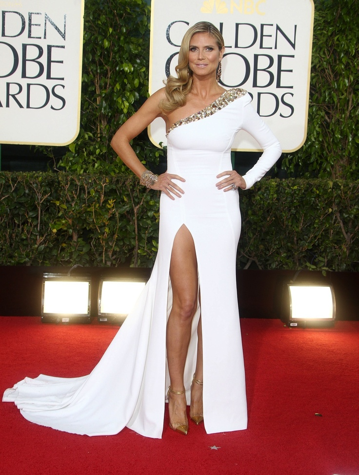 Heidi Klum at the Golden Globes in a white gown with a high slit and jewel accents #white #gown #highslit #goldenglobes #2013 #style #swimspot swimspot.com