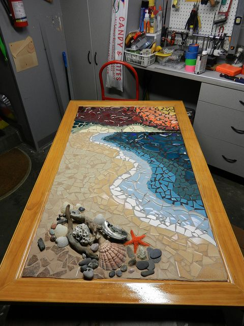 Drake's Beach Shoreline Mosaic 3' x 5' mixed media mosaic, broken plates, vintage salvaged tile from Habitat 4 Humanity, ceramic floor tile, glass tile, shells, driftwood, abalone and beach rocks from California coast. Three colors of grout: Sandstone, Delorean Gray, and Charcoal. Handmade Oak frame with Danish oil rub. I plan to do a light epoxy finish on the rocks and shells to make them look wet.