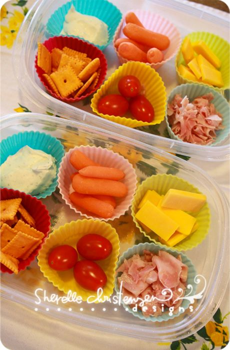 Kid Lunch Idea, using cupcake liners to separate items....this would be ideal for our picnics to the zoo and what not.