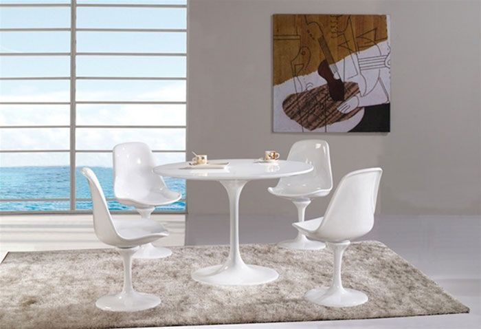 Flower Dining Table:  A modern classic reproduction of the iconic Tulip Table by Eero Saarinen.