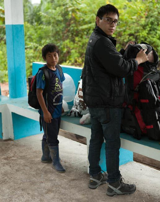 Our 7-year-old 'guide' Miguel, and Chris Aguilar preparing to leave for the forest