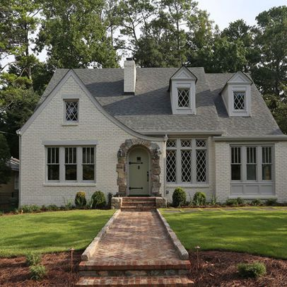 Painted brick house. Stone entryway. traditional - exterior