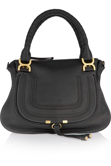 Black textured-leather (Calf) Zip fastening along top Comes with dust bag Weighs approximately 1.8lbs/ 0.8kg  Made in Italy