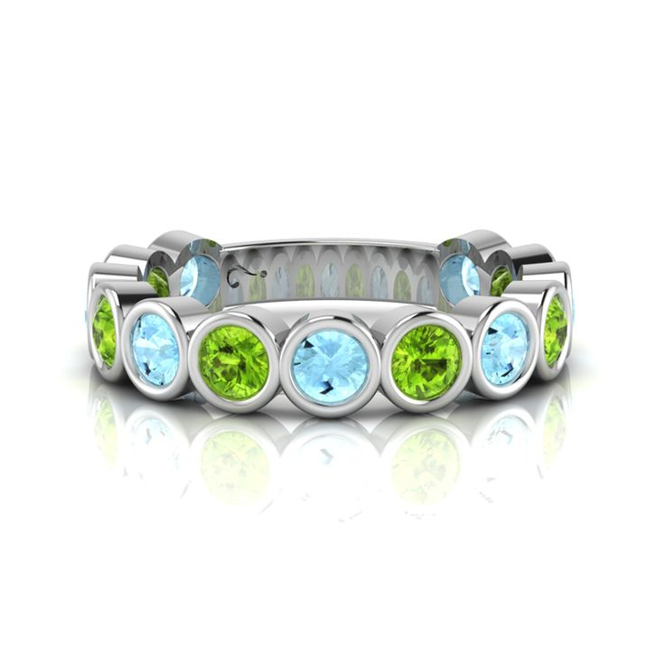 Silver Topaz and Peridot Ring. R2500 Product Code- WR00138