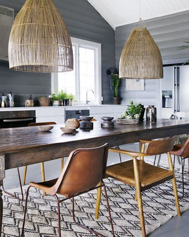 Vakre Hjem & Interior --- Is it too early to think about a warm-weather getaway? Never! This kitchen with exotic flair — from the oversized pendant lights to the patterned rug and warm worn-in leather — is giving us serious vacation vibes! The perfect inspiration to kick-off the weekend ahead. Via Vakre Hjem & Interior