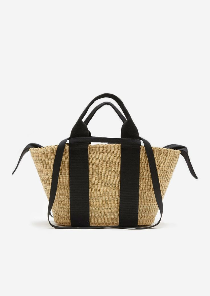 Handwoven inGhanaand designed with an open top, this straw tote features an optional internal black cotton pouch that can be fastened with a knot.Can be worn