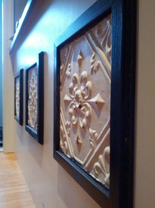 antique tin ceiling tiles in DIY iron-buffed oak frames on my breakfast bar!