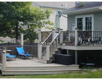 I love this two tiered deck and the fact that they chose to stay with decking as opposed to the much expected patio at ground level...