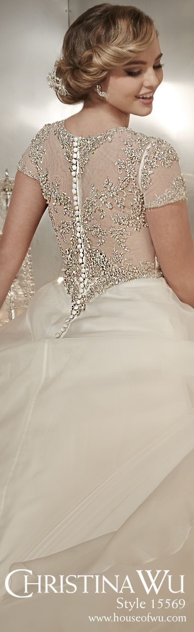 Modest and demur in beaded silky organza. #weddinggown