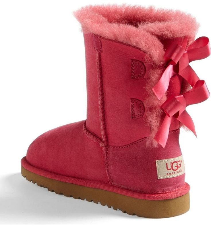 Absolutely adoring these pink UGG boots with super-cozy suede and darling bows. They will make the perfect gift this holiday season for the little one.