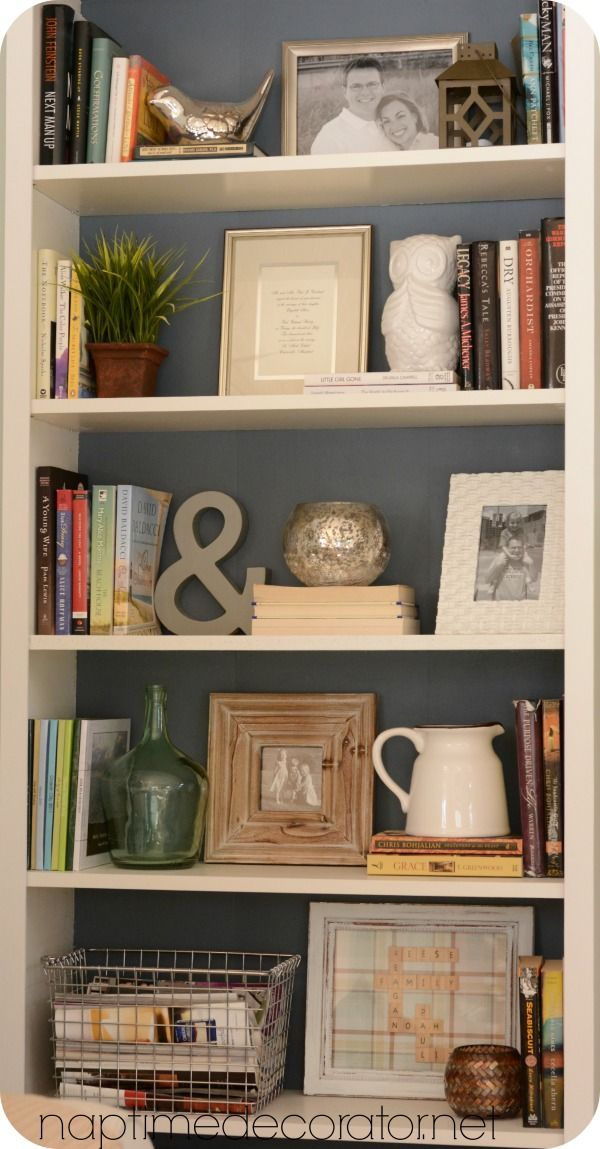 While these items aren't necessarily what would go with your decor, they show how to use a nice variety of items to style a bookcase. Your eye wants to bounce around and see everything!