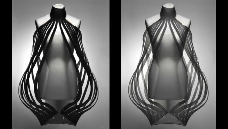 """Is a fashion project about the relation between intimacy and technology.  Its high-tech garments """"Intimacy White"""" and """"Intimacy Black"""" are made out of opaque smart e-foils which become increasingly transparent based on close and personal encounters with people.  Social interactions determine the garments' level of transparency, creating a sensual play of disclosure."""