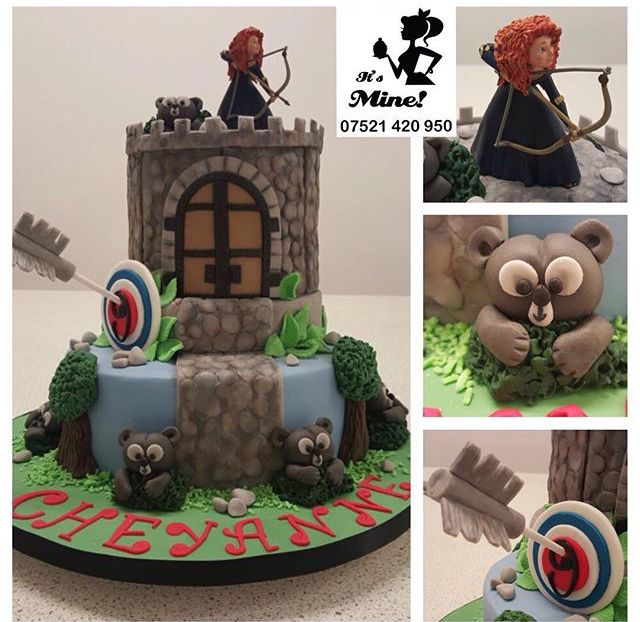 A three tier brave cake with Princess Merida at the top with her bow and arrow, underneath her sit wildlife, and nature by It's Mine Cakes