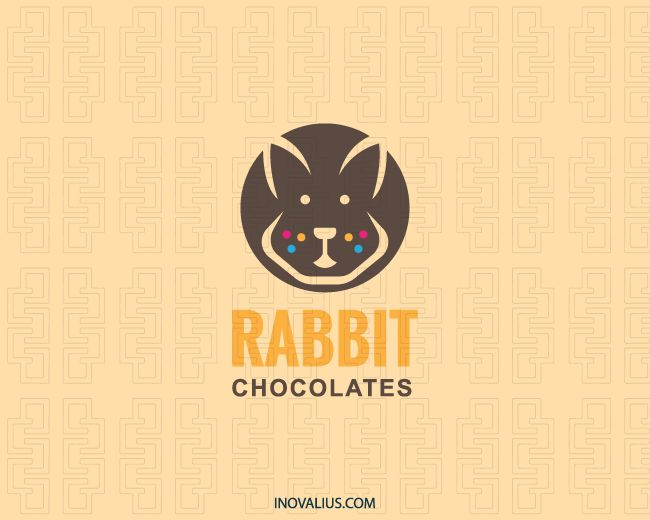 Rabbit Chocolates is a circular logo with a rabbit head in the center together with freckles with the colors blue, brown, yellow and pink.( rabbit, animal, chocolate, candy, bullets, confectionery, food, sweet-shop, bunny, food service, truffle, chocolate maker, chocolate delivery, logo for sale, logo design, logo, lototipo, logotype).