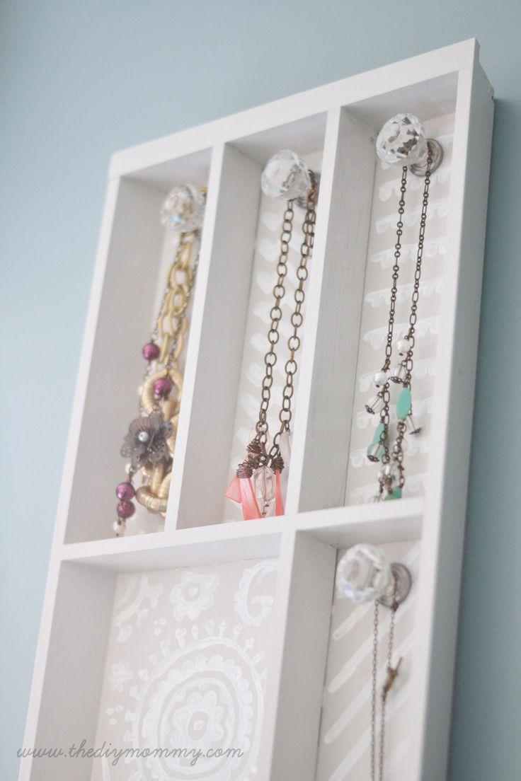 Transform a silverware organizer into a jewelry rack.