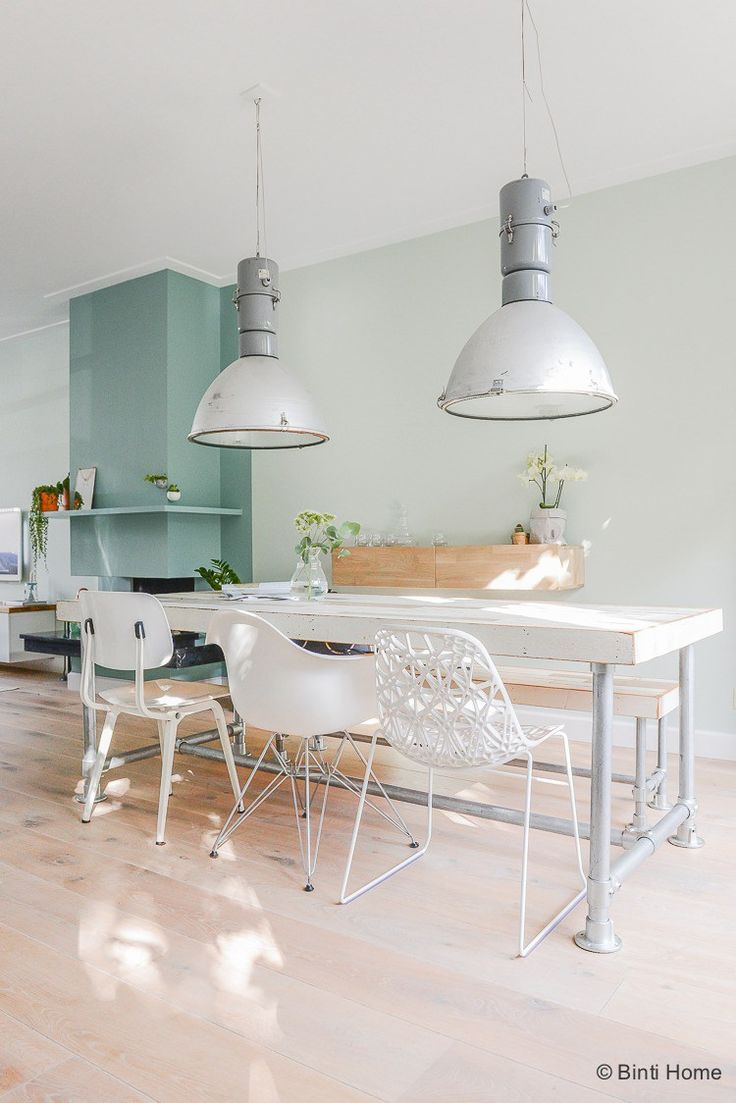 vintage oversize pendant lights in the dining room, white chair mix