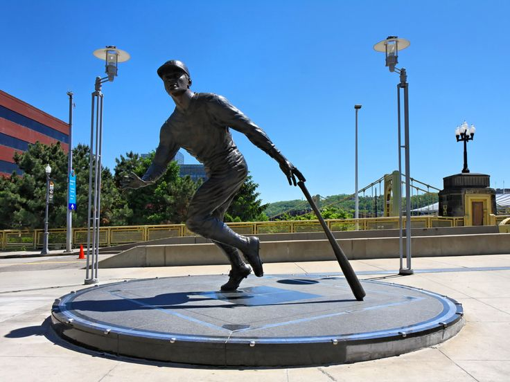 Statue of Roberto Clemente Pittsburgh, PA - There are statues of the Pirates Hall of Famers at various points around PNC Park. This is Roberto Clementes statue. Its by the center field gate, with the Roberto Clemente Bridge nearby. The base of the statue has a baseball diamond on it. The three bases are clear squares containing dirt from three fields where Clemente played: Santurce Field in Carolina, Puerto Rico, Forbes Field, and Three Rivers Stadium.