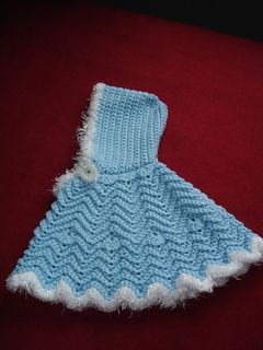 From the website: It's too cute—a ripple poncho edged in a fashionable fur yarn! Best of all, it's washable, which makes it just right for babies.