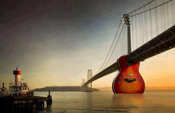 The Guitar with the Big Bridge!
