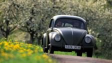 VW Beetle on country road (Credit: Alamy)