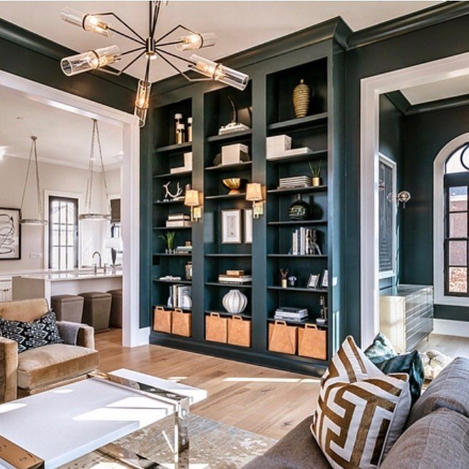 Beautiful Dramatic Living Room With Built In Bookshelves And High End Furnishings By Ramagecompany Bookshelves In Living Room Home Home Living Room