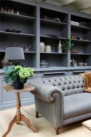 FleaingFrance Brocante Society My favorite colors.......deep grey buttoned chesterfield sofa and fabulous bookcases http://www.martkleppe.nl