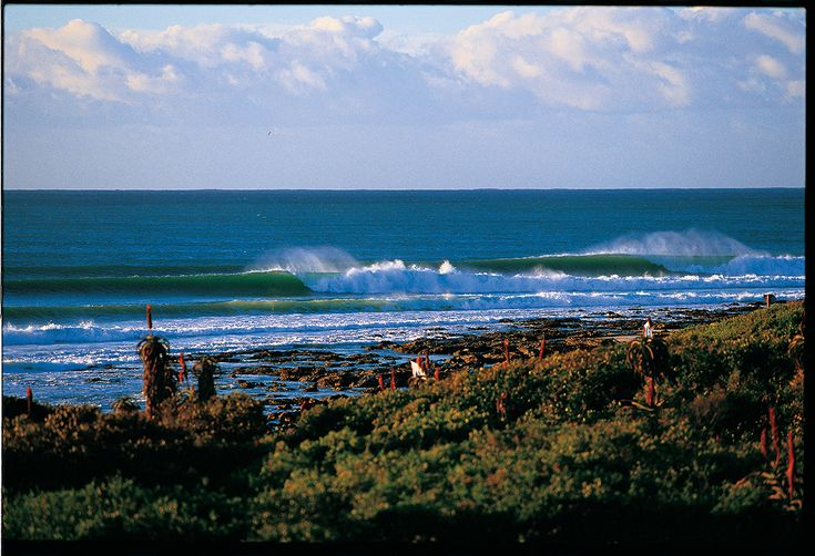 """""""This was shot in 2002 on a clean offshore morning,"""" says photo editor Grant Ellis. """"The Supertubes section of Jeffery's Bay is one of my favorite places on the planet to shoot and surf. There is nowhere else like it."""" Photo: Ellis"""