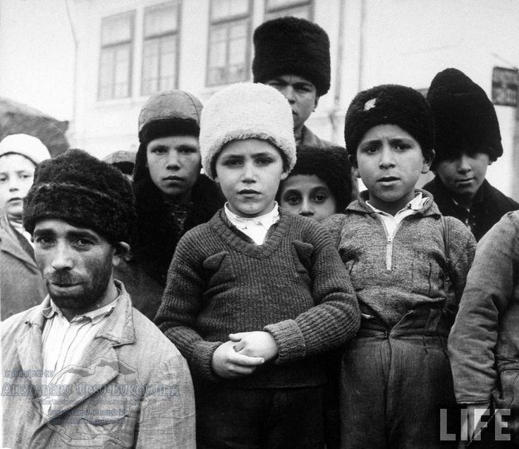 75.Turtucaia.Young Bulgar boys w. man on street in the city.
