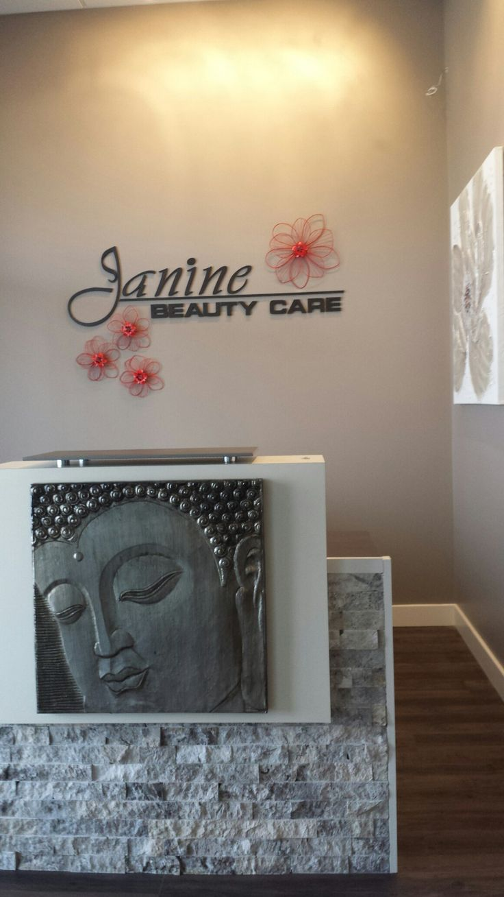 Reception desk I designed with an old desk refinished in limestone and glued a foiled canvas zen picture on the front.