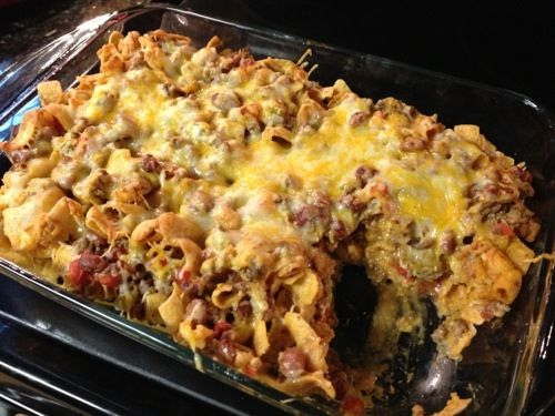 Gather the Goods 1 lb hamburger meat 1 bag Fritos 1 can Rotel 1 can chili beans 1 can enchilada sauce 1 can green chilis 2 oz cream cheese 1 cup chopped onion Shredded Mexican cheese I said cooook …