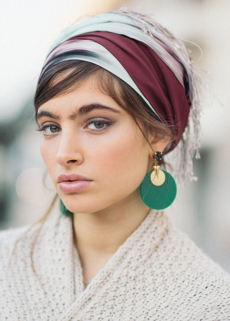 The fringe turban is made of a smooth, printed fab…