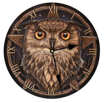 """A wall clock featuring a golden eyed owl. Artwork by Lisa Parker. Takes 1 AA battery - not included. 11 1/2"""""""